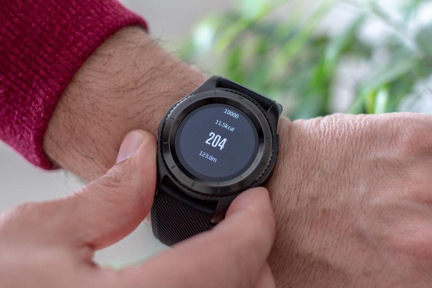 man wearing a fitness tracker watch