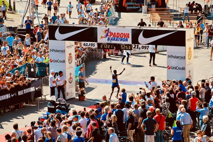 marathon finish line with sponsor logos