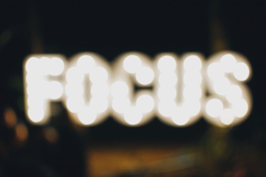 blurred photo of the word focus