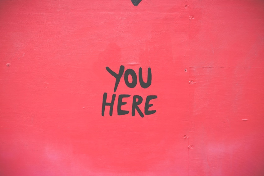 wall that says you here