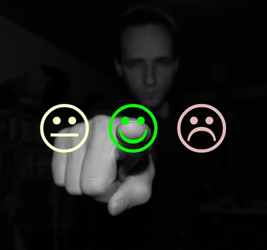 man pointing at positive smiley face