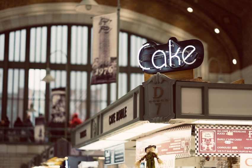 store with cake sign