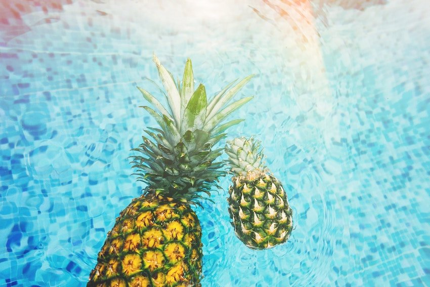 pineapples in clear water