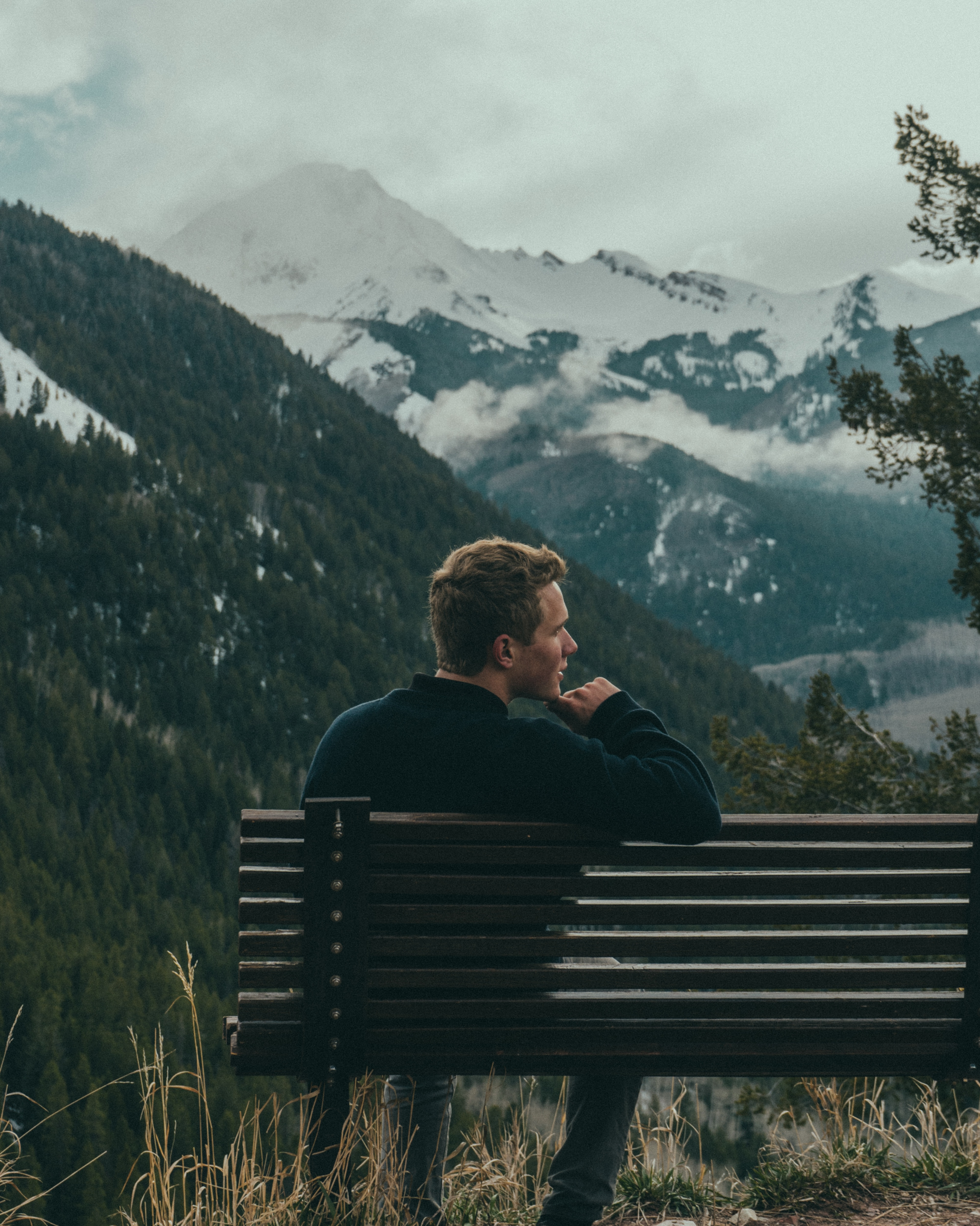 man sitting on bench and thinking