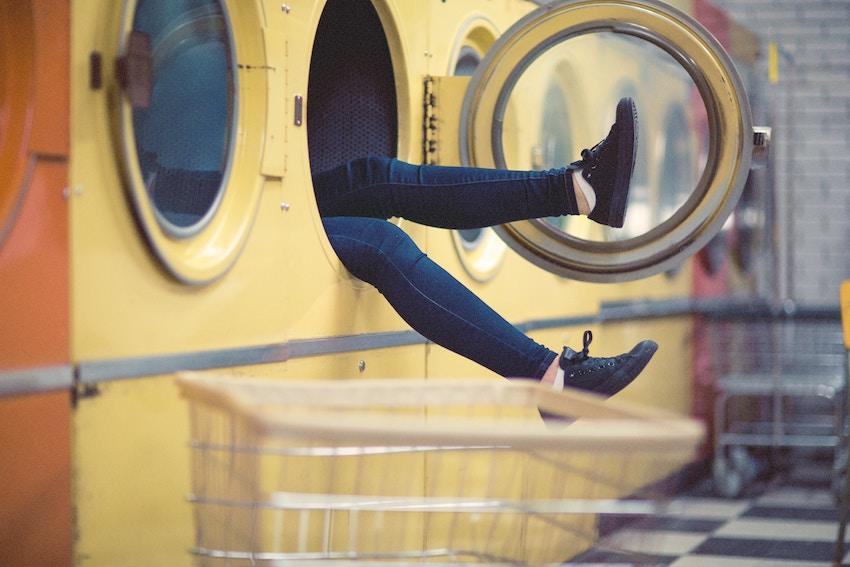 person stuck in a washing machine