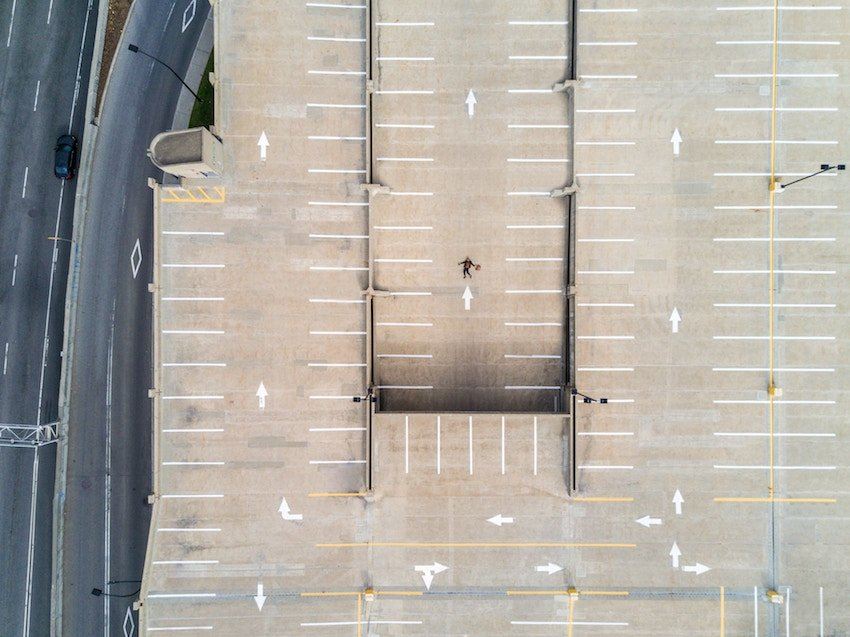 aerial view of person in parking lot