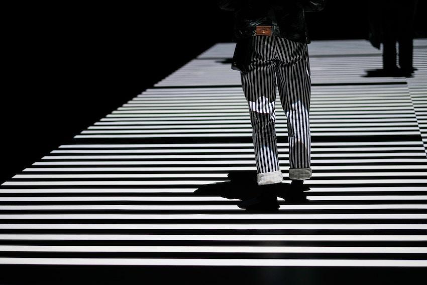 person in stripes on crosswalk