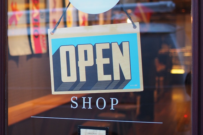 store sign that says open