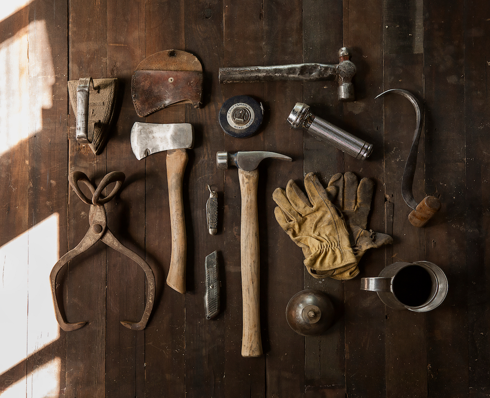 set of tools laid out in aerial view on hardwood surface