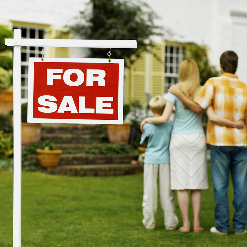 family looking at recently sold home